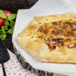 Roasted Tomato Galette is a rustic free form tart of roasted garlic and tomatoes and cheese pastry.