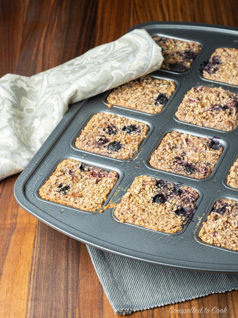 Baked Berry and Coconut Oatmeal baked in individual squares.
